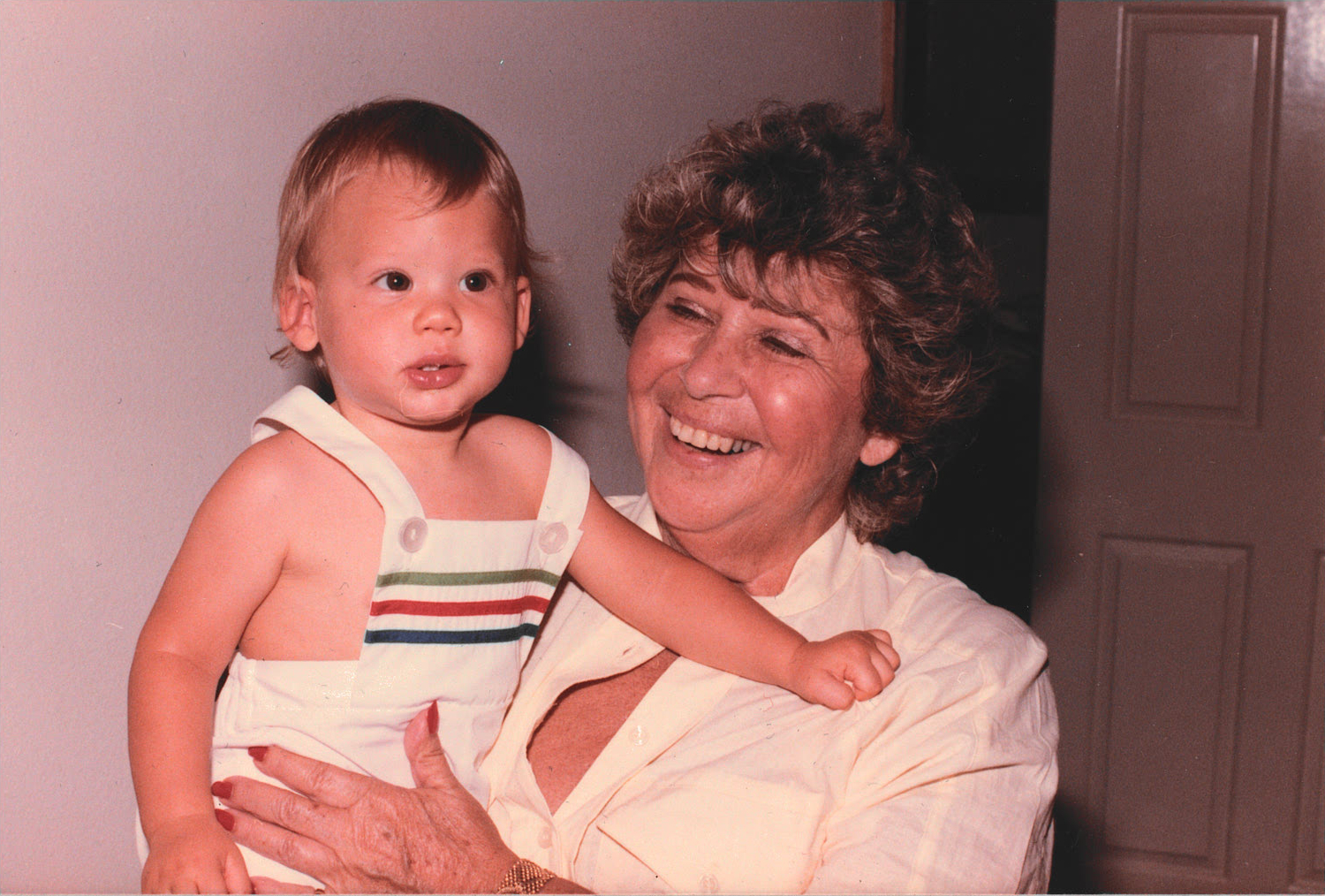 Esther Passy, holding Austin Passy as a child